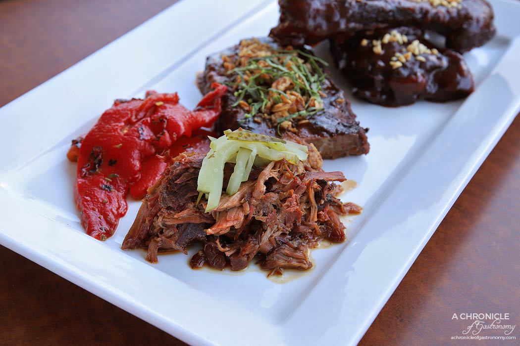 Bluestone American BBQ - Pit braised pulled lamb, Fire roasted red peppers