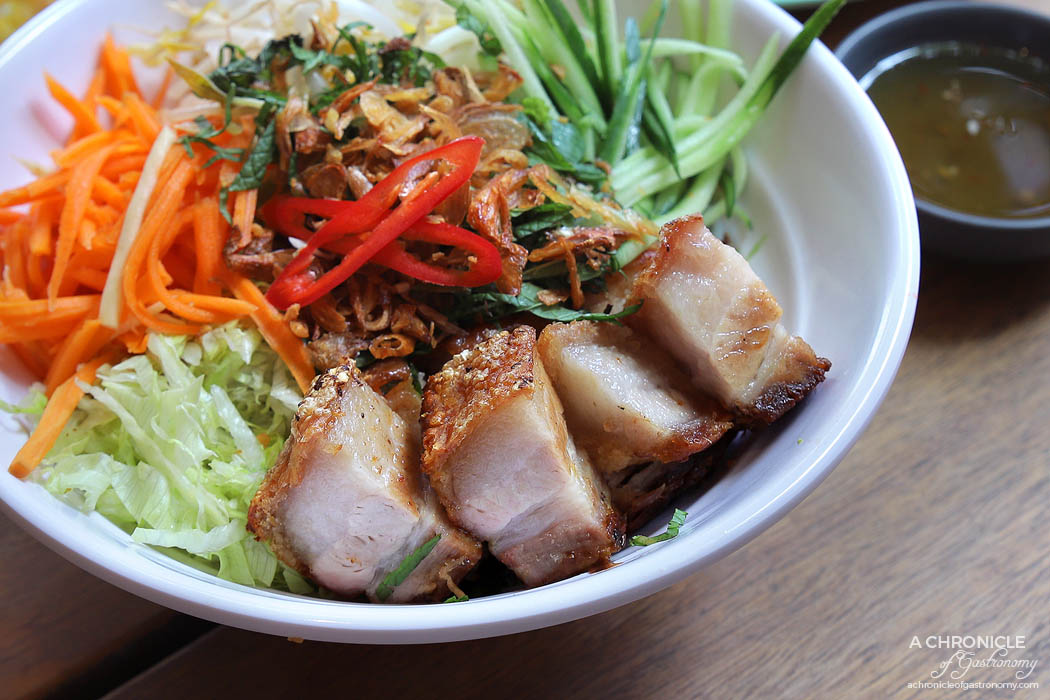 Ms Kim HWKR - Vermicelli noodles salad with crispy roast pork, bean sprouts, cucumber, iceberg lettuce, mixed mint, fried shallots, fried garlic, pickled carrot, Special Dressing ($15.80)