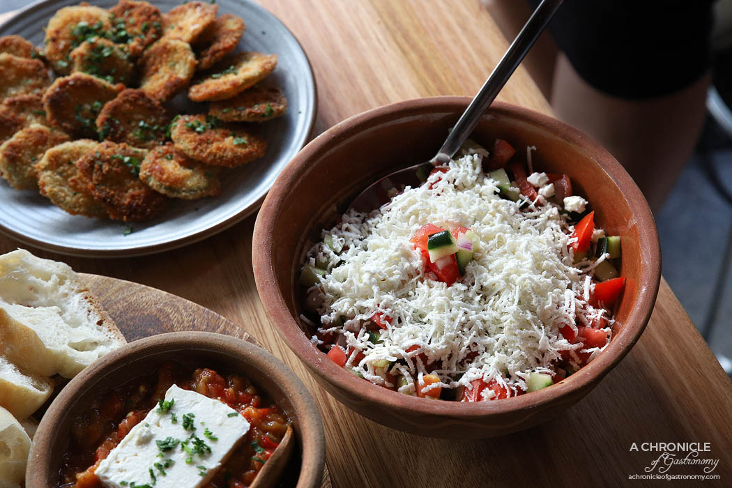 Le Lee - Shopska salad - Tomato, cucumber, onion and grated fetta, Fried zucchini with garlic and parsley
