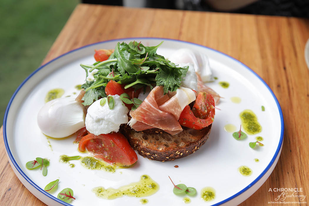 Toorak Tracktor - Heirloom Doncaster tomatoes, San Danielle prosciutto, Shaw River buffalo mozzarella, basil, Zeally Bay seeded sourdough, poached eggs ($21.50)