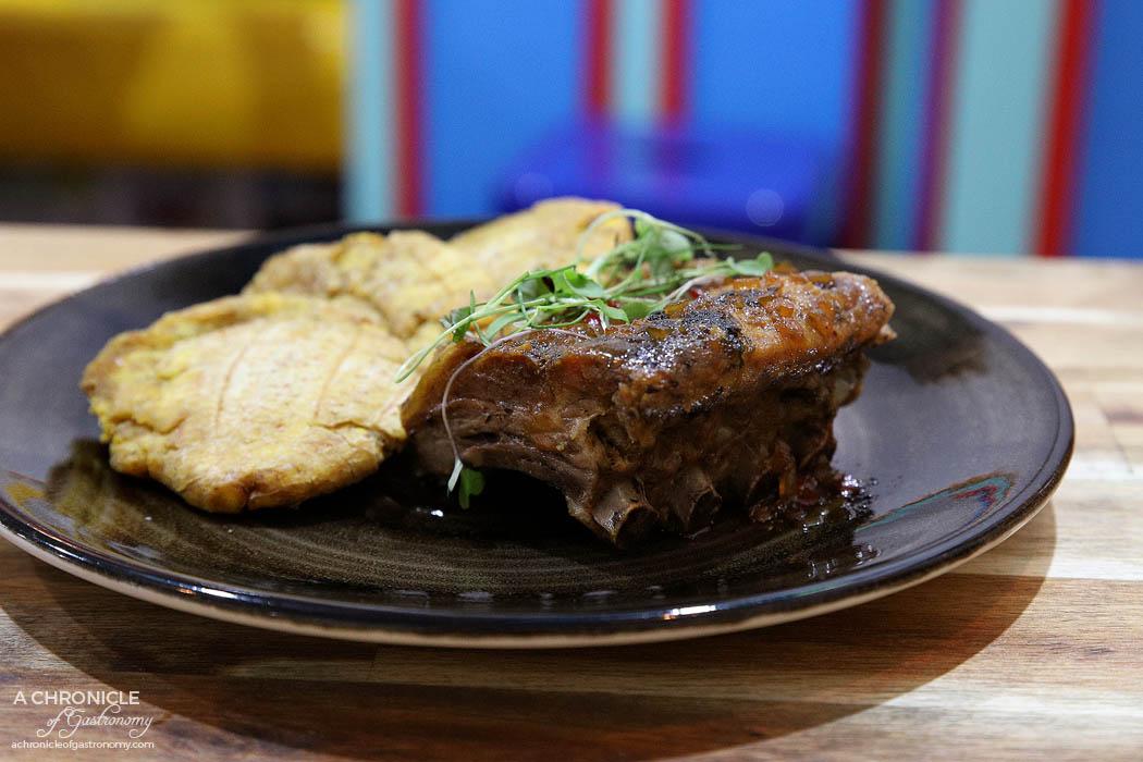 Club Colombia - Costilla de cerdo con salsa de panela del Valle y aguardiente - Slow cooked pork spare ribs cooked on sugarcane sauce and aguardiente ($22)