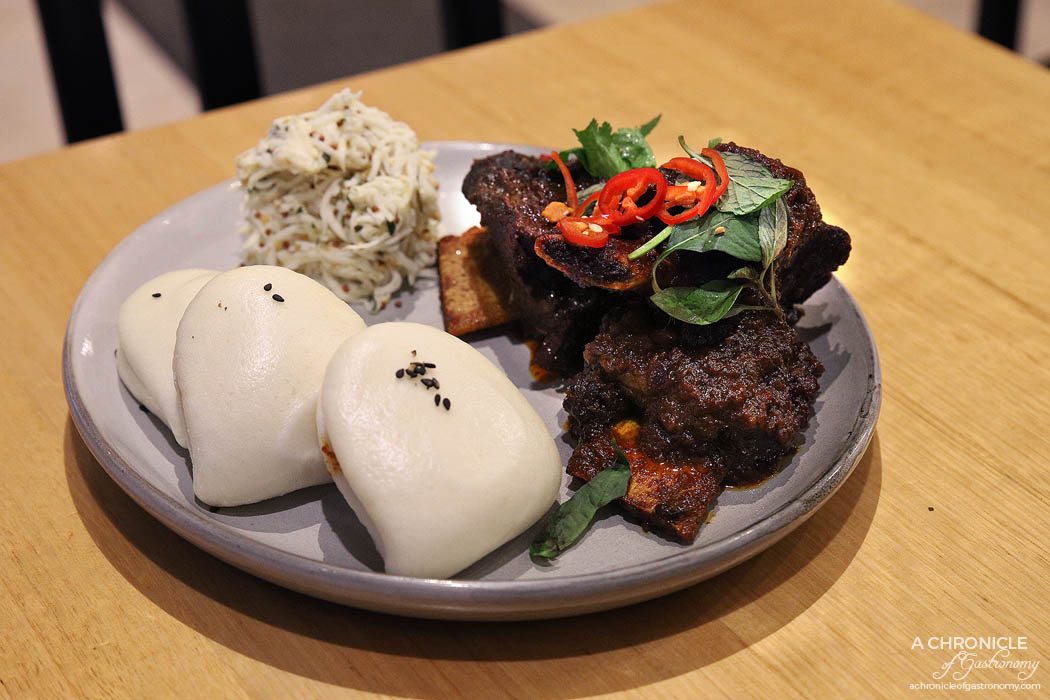 Infuse - Chilli beef short ribs w steamed bao, celeriac remoulade, sesame, coriander ($26)