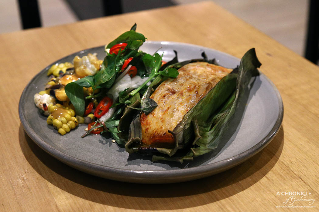 Infuse - Red curried Atlantic salmon in banana leaves, served w vegetable ceviche of cauliflower, black bean, bell pepper and charred corn, with pickled fennel and dill ($26)