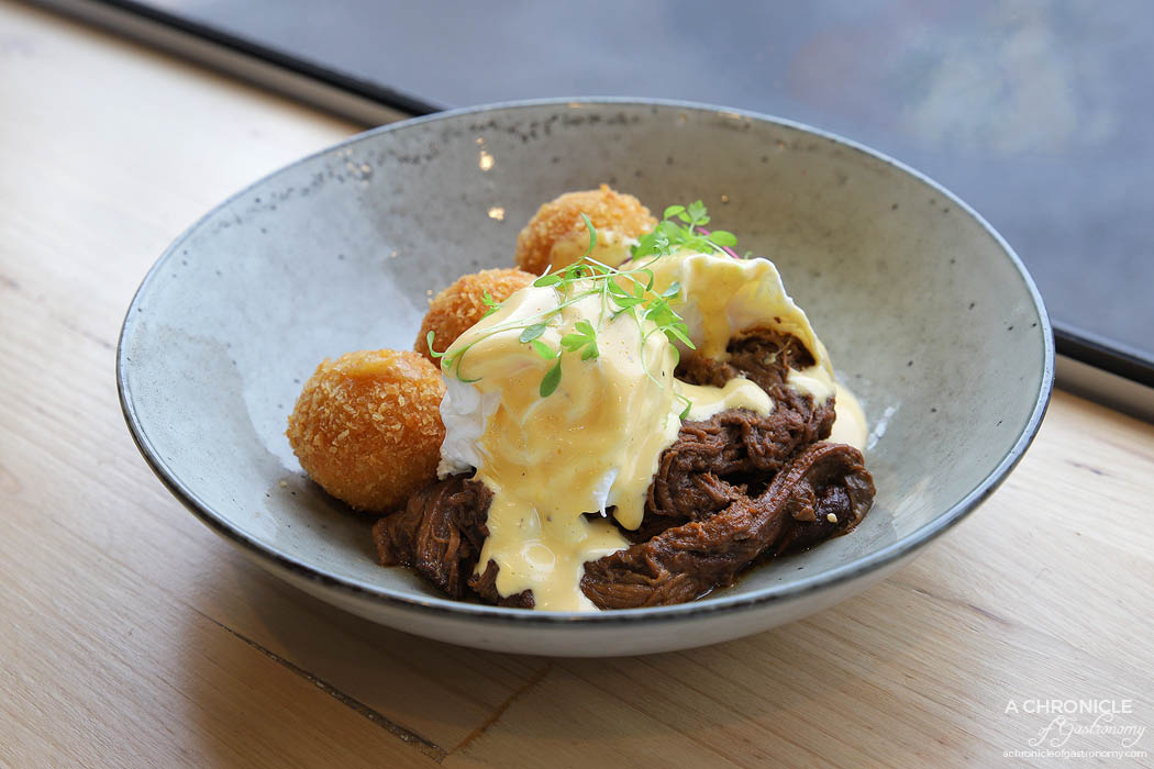Touchstone - Smoked beef brisket benny w potato, chorizo & cheddar croquette, poached eggs and hollandaise ($19)