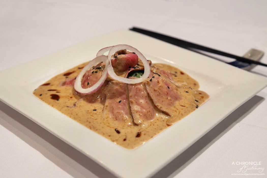 Ayame - Gyu Niku Tataki - Rare sirloin beef, baby spinach, Ayame special sauce ($19)