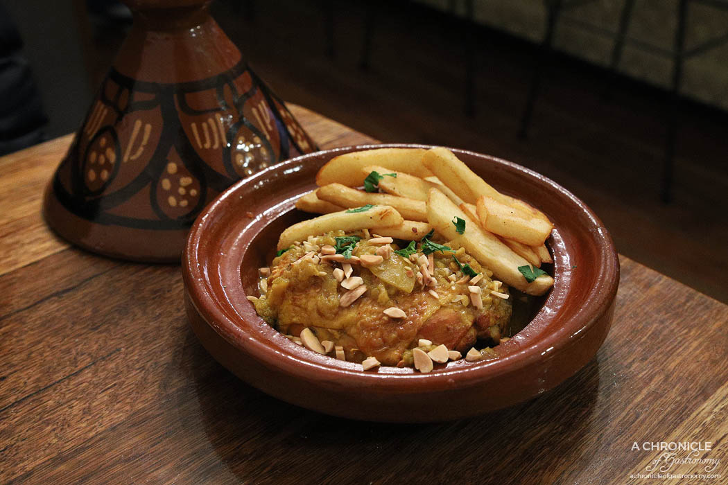 Casa Tajine - Chicken Tajine with Preserved Lemon - Marinated overnight in seven spices and cinnamon, with olive oil, onions, fresh ginger, preserved lemon, coriander and olives ($18)