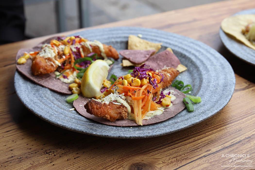 Hecho en Mexico - Fish Taco - Blue corn tortilla w beer battered Hoki, green papaya and carrot slaw, garlic jalapeno aioli and ricotta salata ($8 ea)