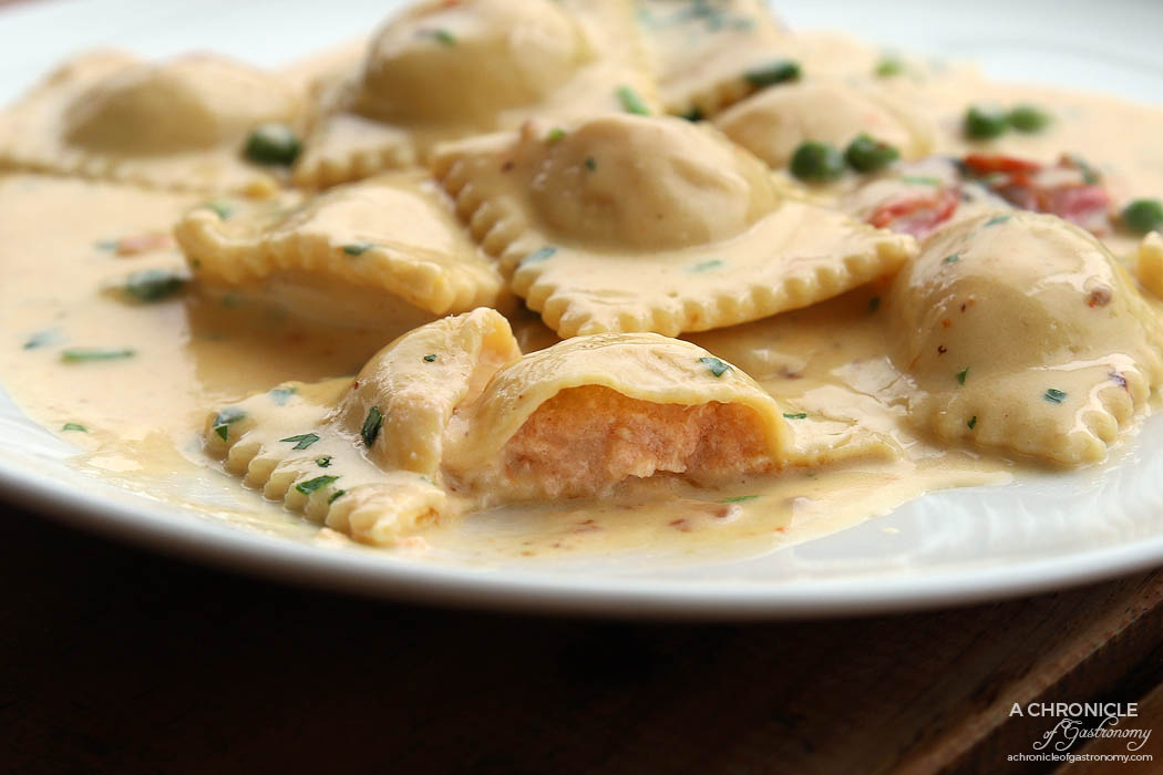 Shop 225 - Homemade Ravioli - Fresh pasta filled with salmon and mascarpone, served with a creamy, green peas and roasted tomato sauce ($25)