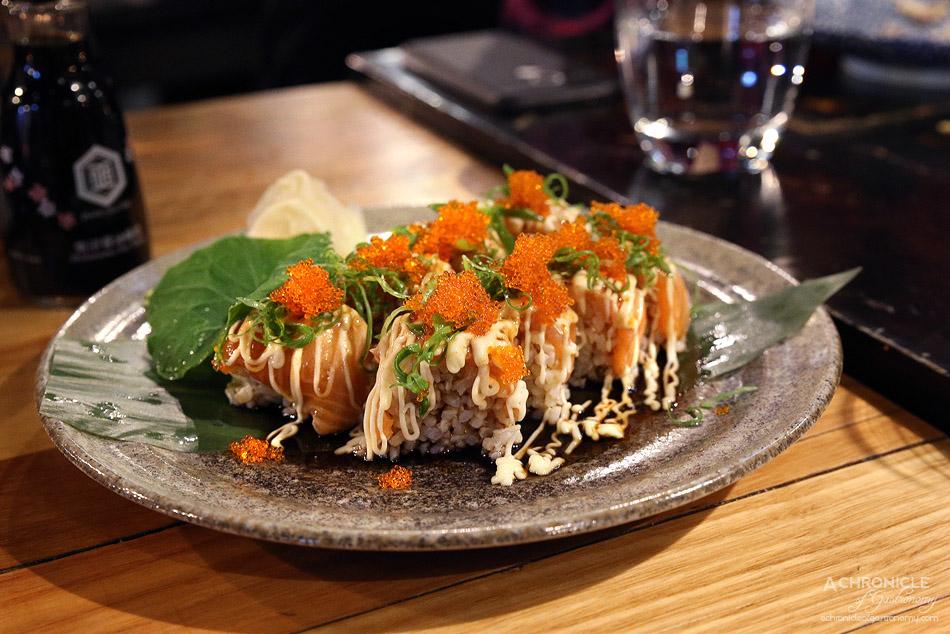 Ichi Ni Nana - Sake Teriyaki Mayo Hako Sushi - Seared salmon block pressed sushi seasoned with teriyaki and Japanese mayo, topped with tobiko ($20)