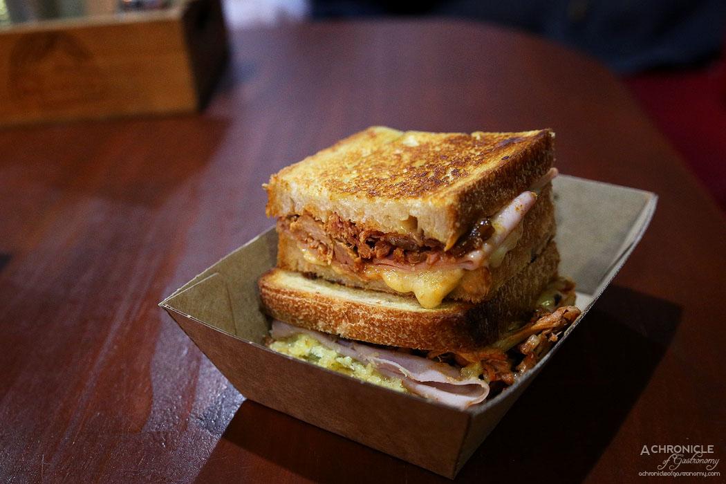 Mr Scruff's - Cubano Toastie - Pulled Pork, Ham, Smoked Cheddar, Dijon Mustard, Pickles ($13)