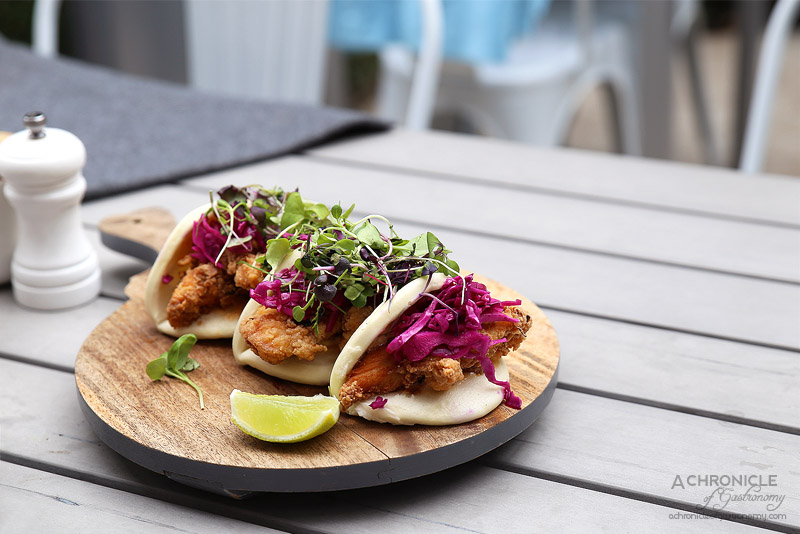Fourth Chapter - Southern fried chicken bao w pickled cabbage & sriracha aioli ($19.50)