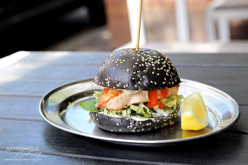 Tank Fish and Chips - Grilled salmon, lemon and dill may, mint and cucumber slaw on a squid ink brioche bun