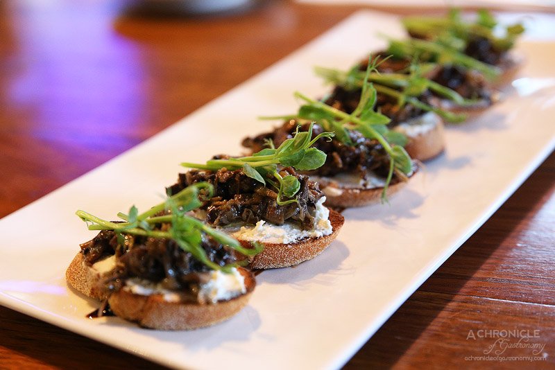 Vault Cafe Bar Restaurant - Mushroom crostini with sprouts and balsamic