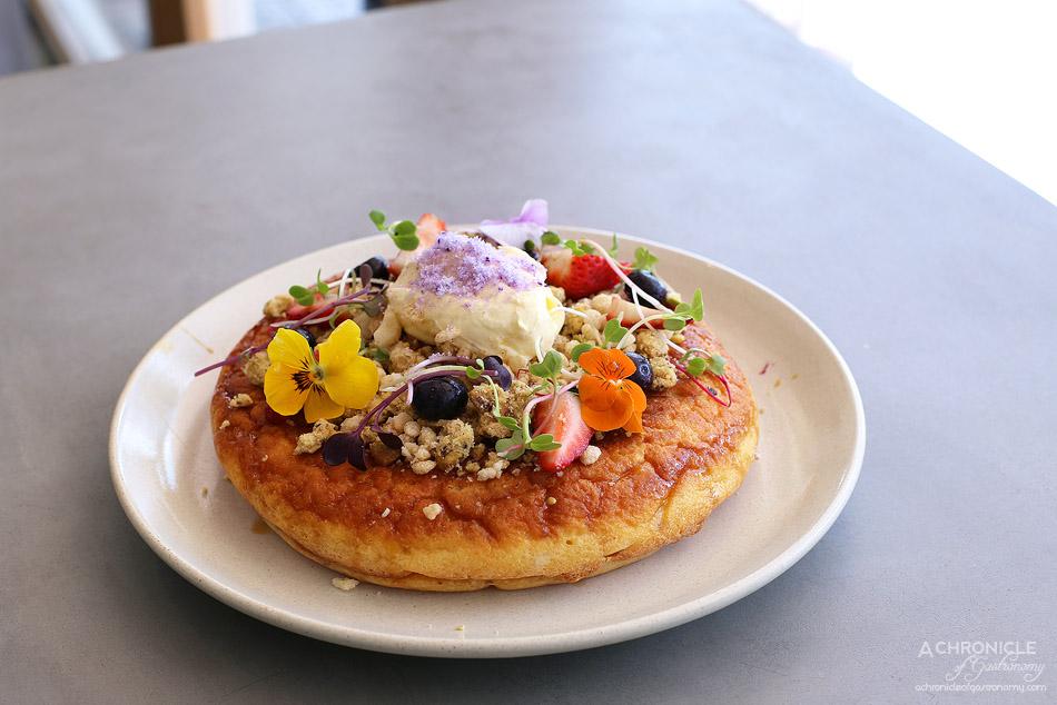 1809 - Blueberry ricotta hotcake w mascarpone, fresh berries, coconut nectar, macadmia and pistachio crumble ($19)