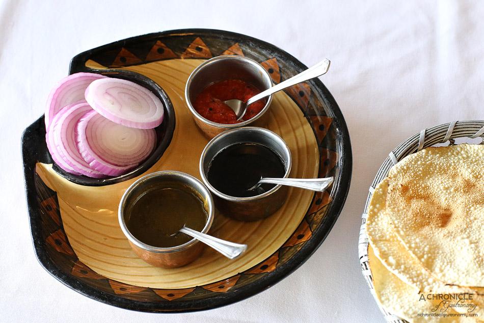 Bhoj - Home made chutney (Sweet tamarind, Coriander and mint, Red Chilli) and papadums