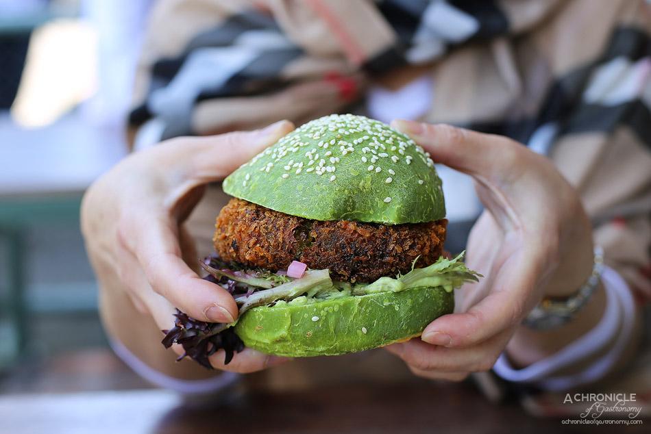 Collective Espresso - Chickpea Greenpea & Potato Burger - Crispy Quinoa, Sriracha mayo, house pickles, lettuce, sweet potato curly chips on a matcha bun ($17.50)