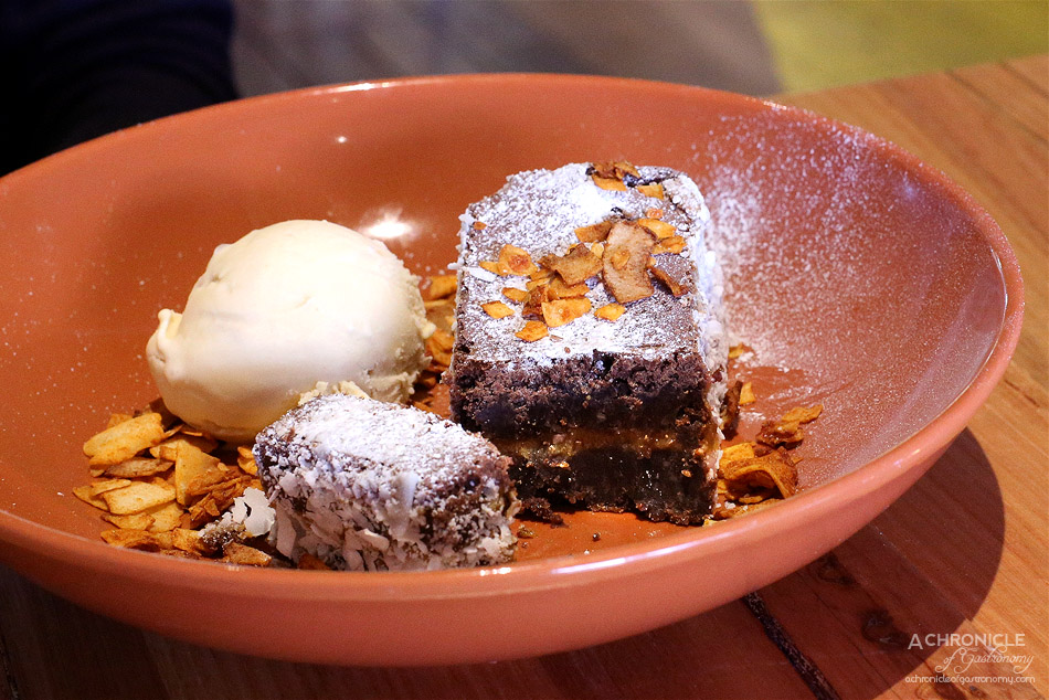El Atino & Co - Chocolate Sweet Sin - Homemade GF Brownie filled with dulce de leche served with house-made dulce de leche ice cream and toasted coconut ($12)