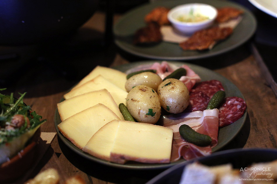 Shifty Chevre - French Raclette w potatoes, prosciutto, cured ham, French salami, cornichons ($24)