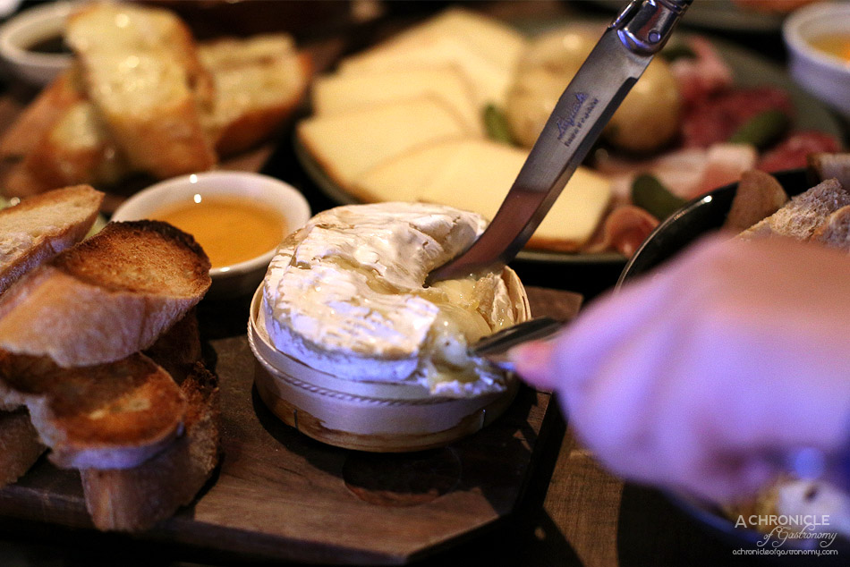 Shifty Chevre - Baked camembert - French Camembert roasted w white wine and honey, served w green salad and toasted baguette ($21)