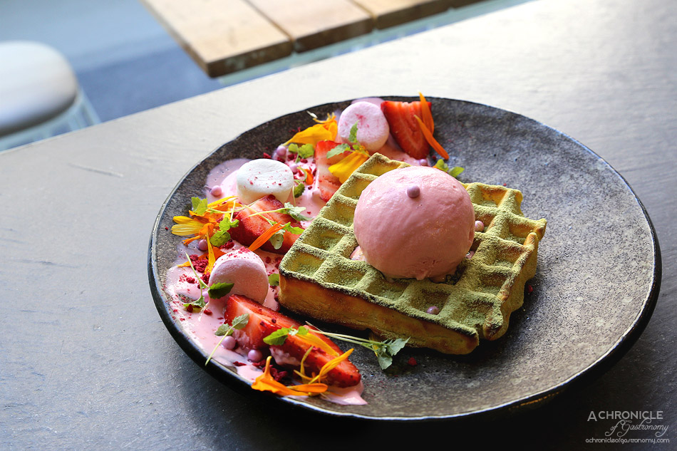 SMAK Food House - Matcha Waffle w fresh strawberries, rose petals, strawberry ice cream, summer fruit and chamomile tea syrup, air dried raspberries and edible violets ($16.50)