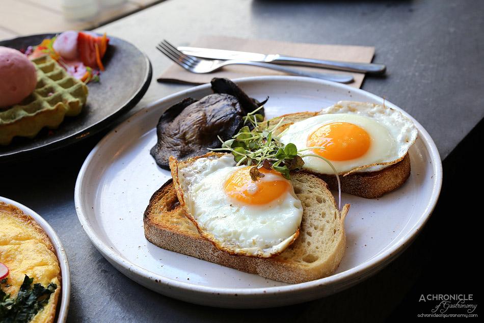 SMAK Food House - Fried eggs on Dench sourdough w slow roasted field mushrooms ($15)