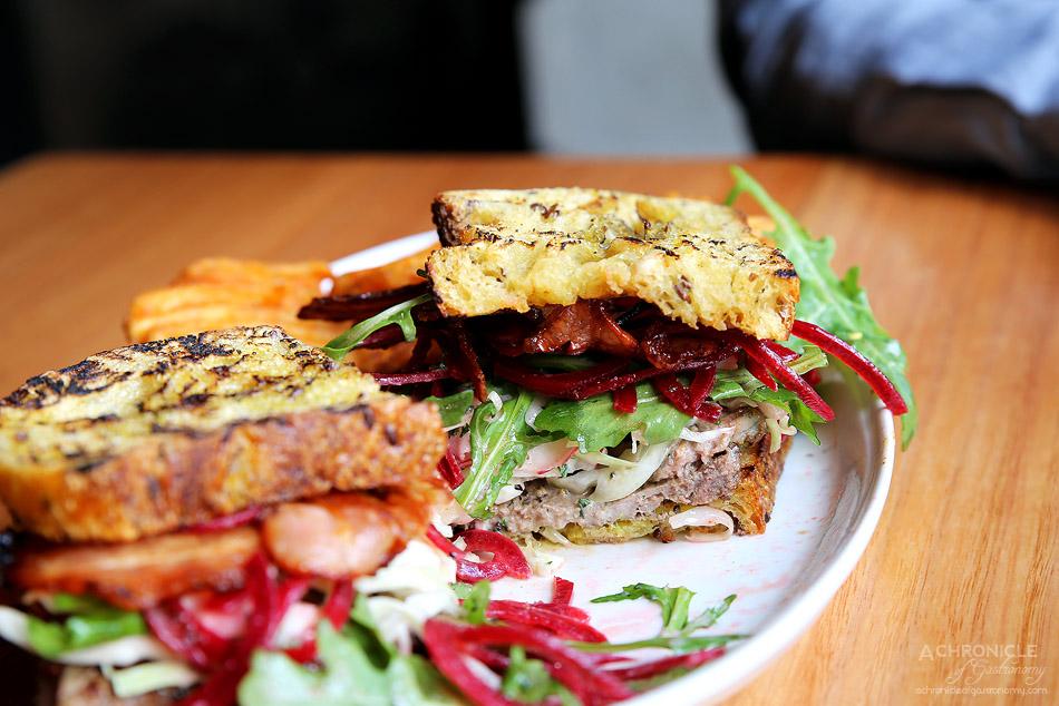 Hotel Barkly - Aged Porterhouse Steak Sandwich - Bacon, curry ketchup, rocket, slaw, beetroot on Woodfrog Bakery pumpkin bread and waffle fries ($19)