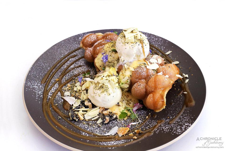 Humble Rays - Puffle Waffle - Hong Kong egg waffle, salted egg custard sauce, coconut ice cream, peanut praline, black sesame crumbs, sea salt caramel sauce, shaved white chocolate ($16)