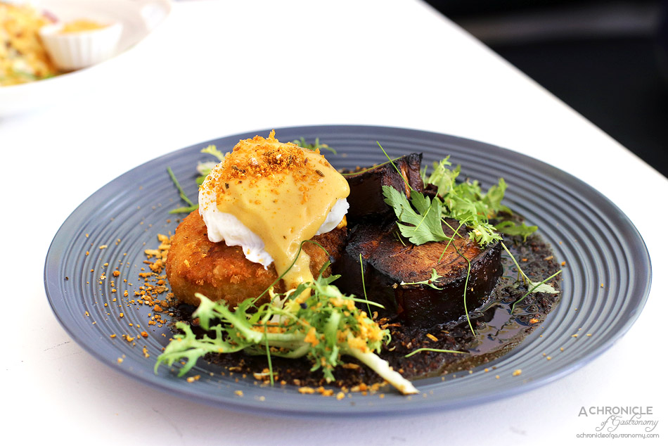 Humble Rays - Eggs Benny - Ginger braised pork belly, miso and potato korokke, poached egg, yuzu hollandaise, chilli bacon jam, parsley crumbs ($17)