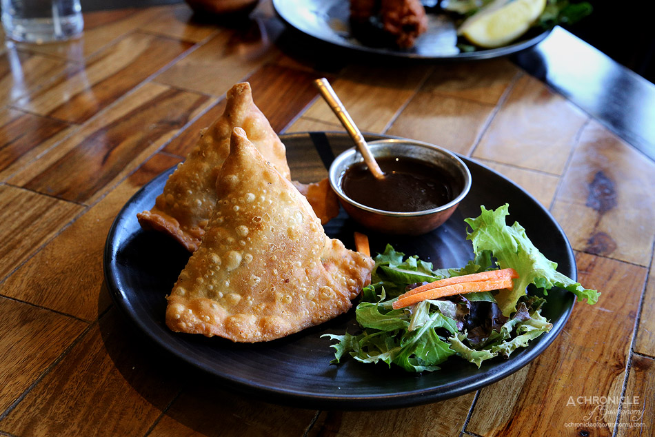 Jai Ho - Samosa - Homemade pastry filled with spiced potatoes, green peas, fresh tempered spices and coriander ($7.50)