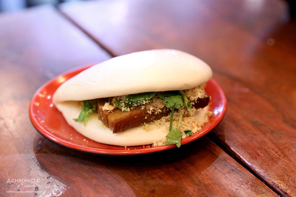 Kitchen Republik - Taiwanese Style Pork Belly Burger - Steamed bun w soy marinated pork belly, pickled bok choy, crushed peanuts, coriander ($7.20)