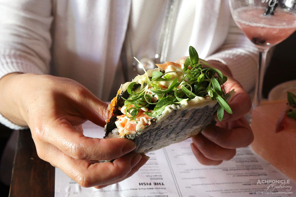 Mr Miyagi - Salmon Nori Taco - Grilled salmon belly, sushi rice, spicy napa cabbage, Japanese mayo, chilli oil ($12)