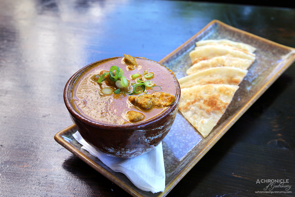 Robarta - Indian Chicken Curry - cooked with spices, onion & coconut milk served with roti ($10)