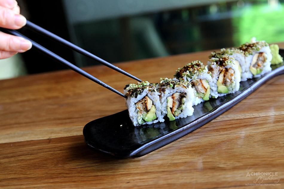 Sake - Unagi eel sushi roll w aburi tamago yaki, wasabi furikake and sticky soy ($21)