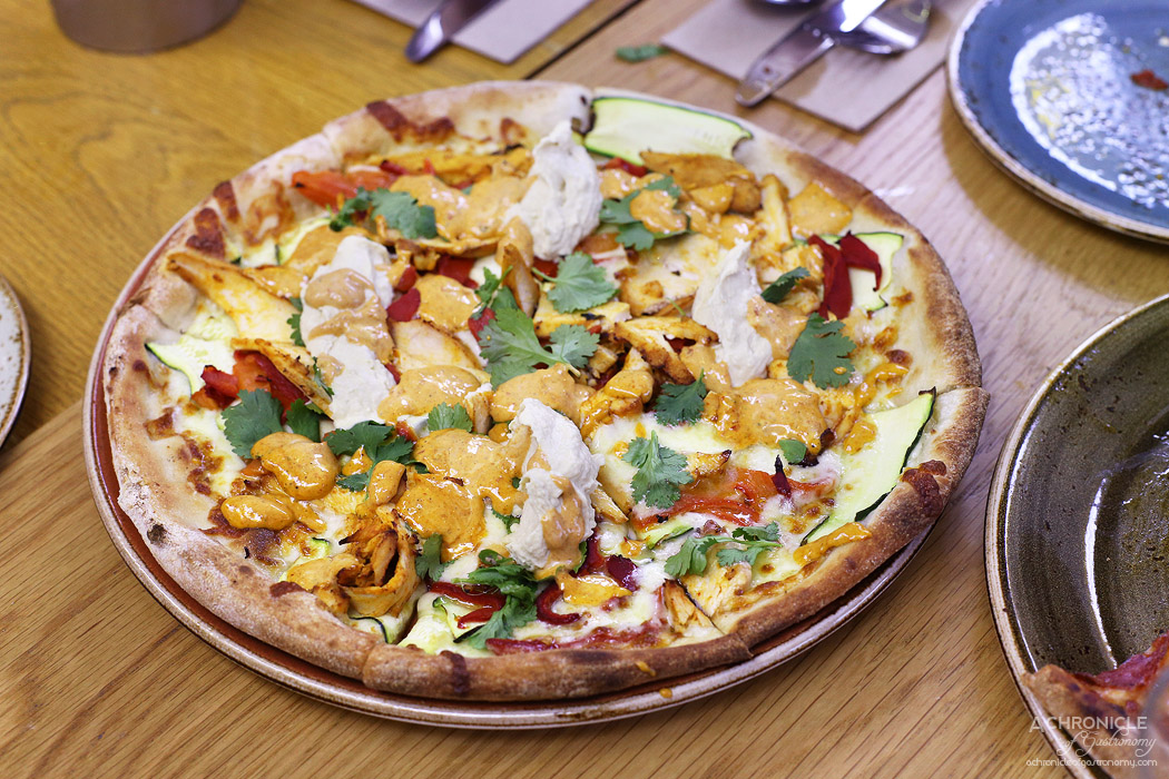 Chatty Vespa - Moroccan Chick - Cheese, harissa chicken, zucchini, peppers, hummus, harissa aioli, coriander ($19)
