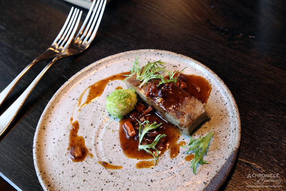 MPD Steak Kitchen - Crispy duck terrine, frisee endive, pickled green quail egg, bacon sauce