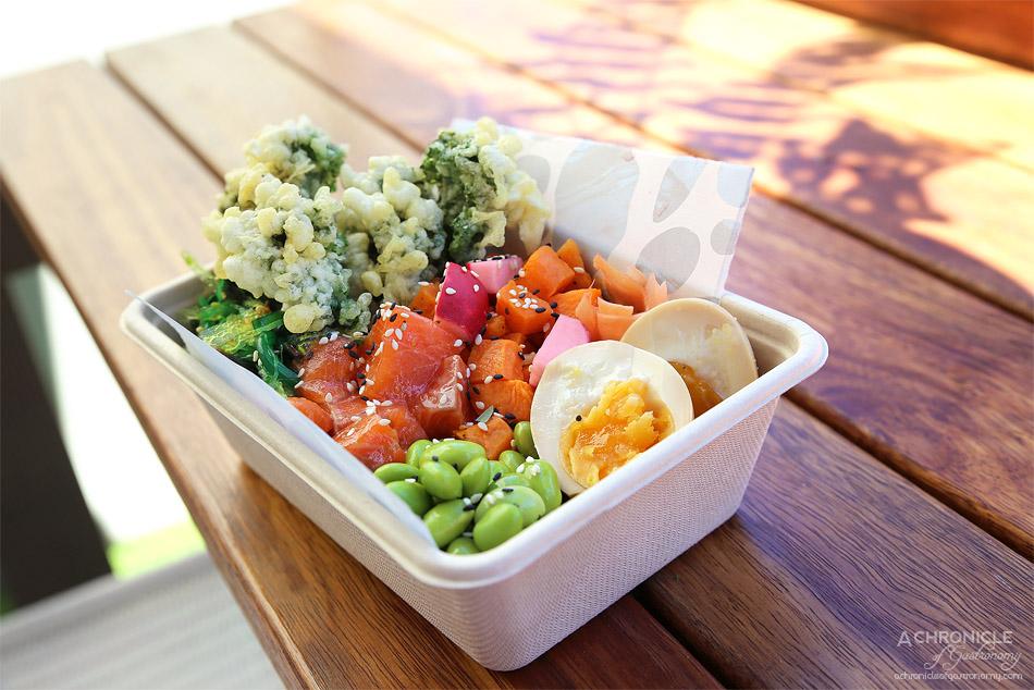 Stepping Stone - Aloha Bowl - Poke style bento w salmon, seaweed salad, edamame, sweet potato, soy egg, radishes and tempura kale ($16.50)