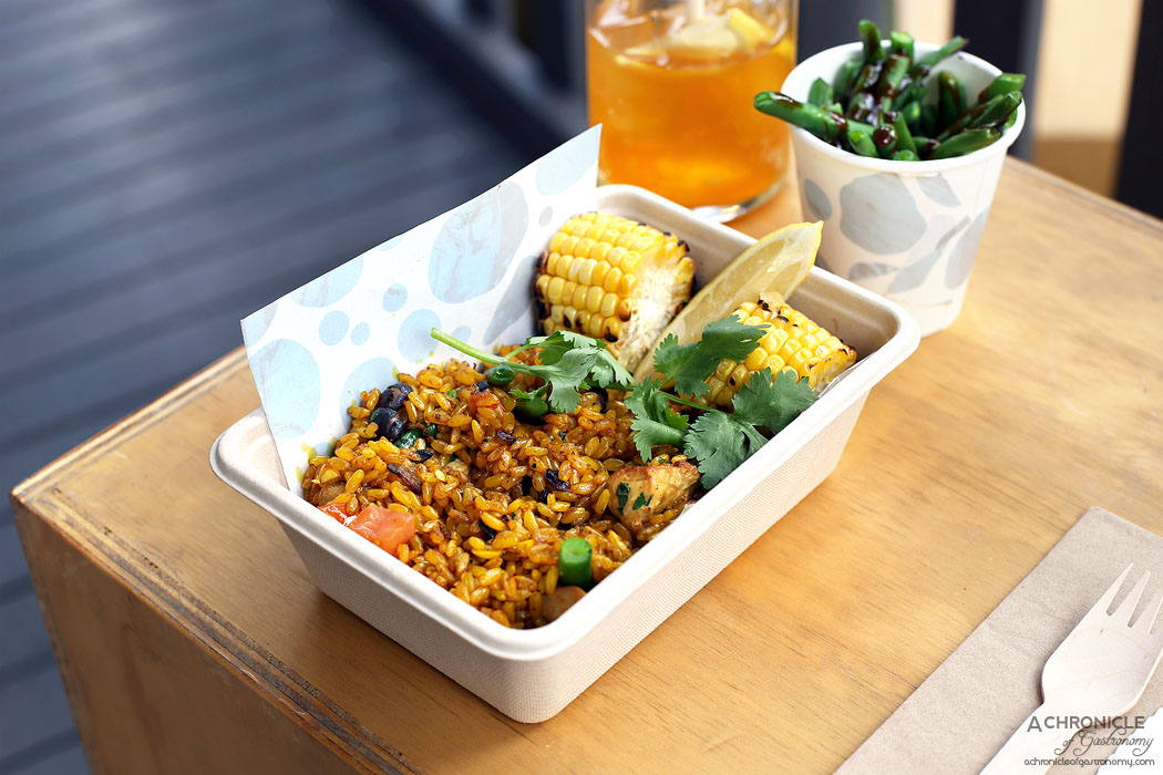 Stepping Stone - Chicken Paella - Grilled chicken breast w turmeric brown rice, grilled corn cob w lemon butter dressing, tomato, coriander, black beans, chives, green beans, fresh lemon w blanched, seared green bean w hoisin