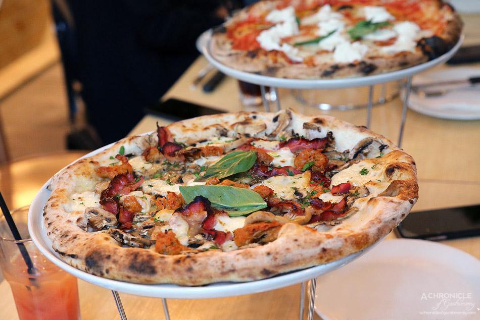 Woodfire Pizzeria - Porco Porcini - Truffle oil, fior di latte, Provolone cheese, Italian pork sausage, pancetta, porcini mushrooms, parsley