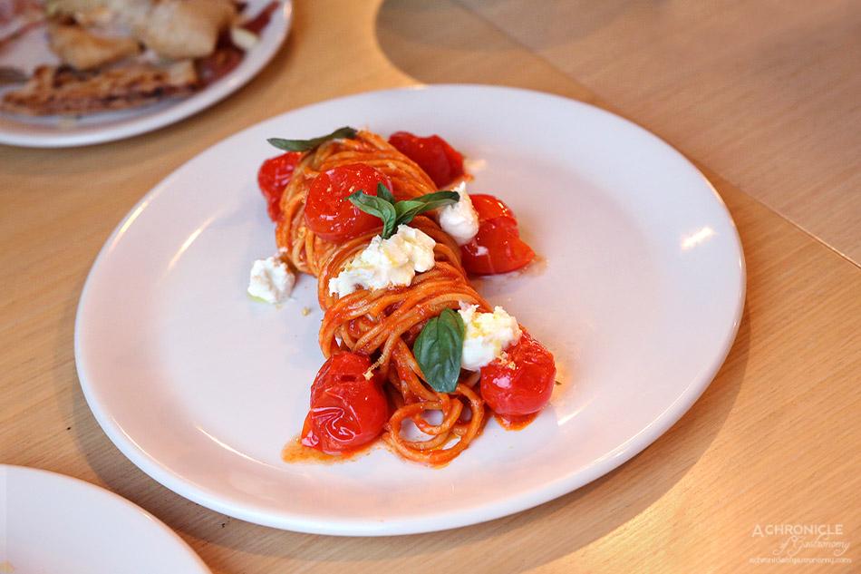 Woodfire Pizzeria - Spaghetti alla chitarra - Italian tomato sugo, cherry tomato, parmesan, burrata, basil and lemon zest ($21)