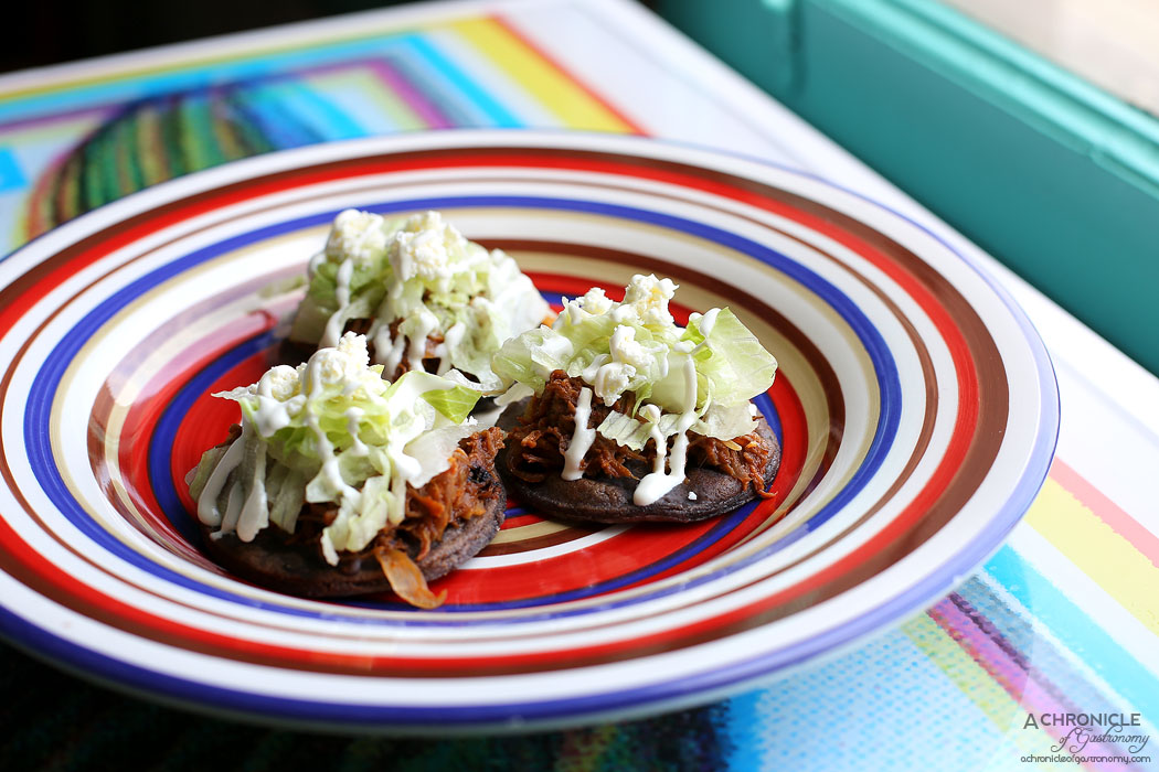 El Sabor by El Cielo - Beef Sopes - Thick corn tortilla served w refried beans, beef, lettuce, cheese, cream ($15)