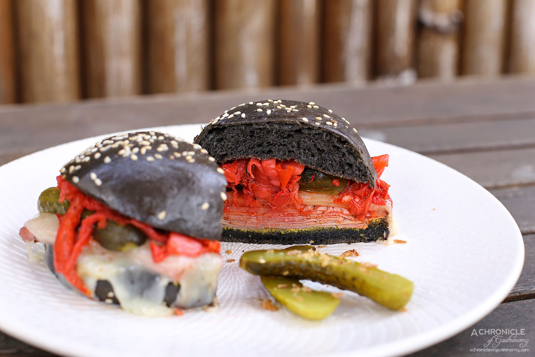 ISIT Cafe - Kimchi Reuben - Sliced pastrami, housemade sesame mustard, provolone, wombok kimchi, gherkins, charcoal bun ($17)