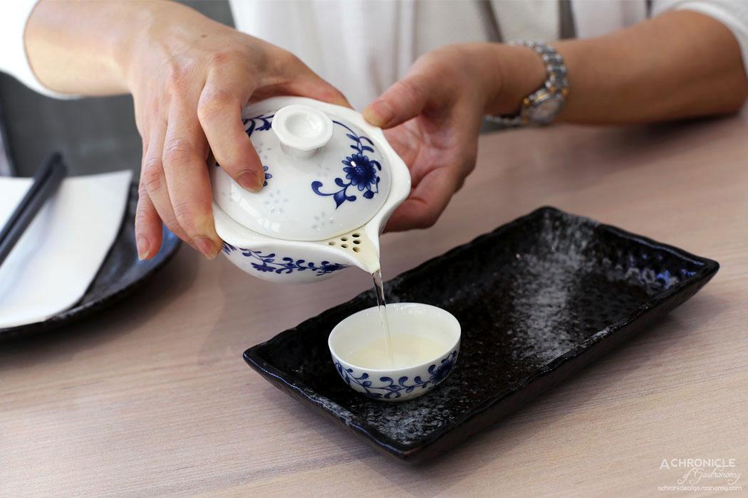 Momo Dumpling + Tea - Rose oolong bossom tea ($5.50)