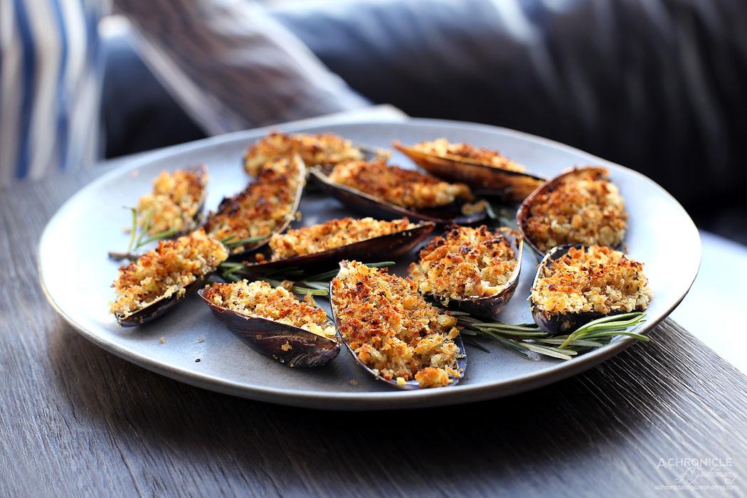 Pizza e Birra - Cozze Gratinate - Oven Baked Mussels, Tomato Crumbs, Oregano ($19)