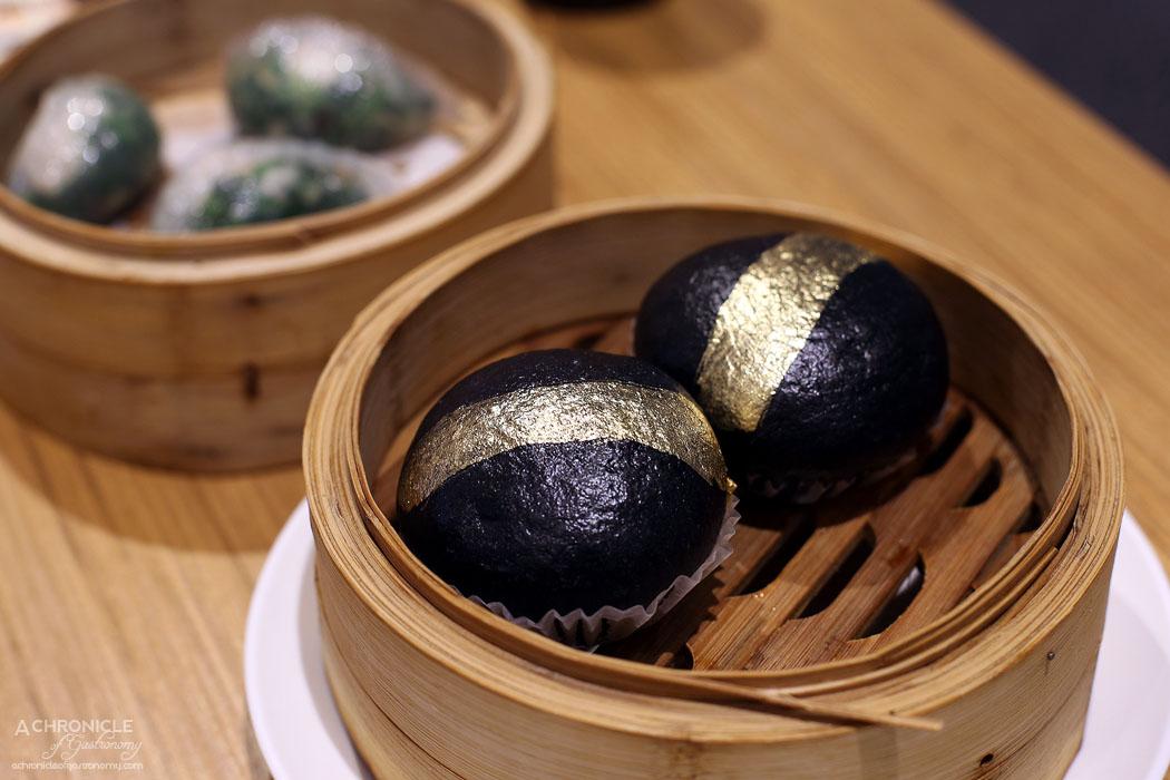 Tim Ho Wan - Gold dusted charcoal lava bun ($8.80)
