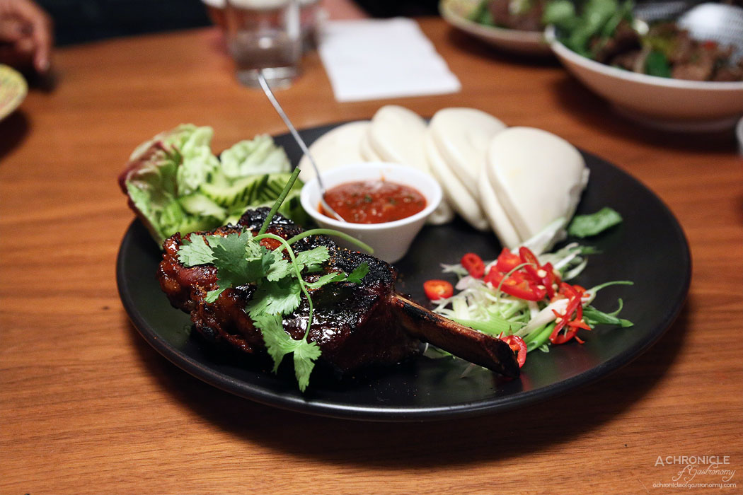Rice Queen - 48-hour cooked spicy beef short rib served with bao buns (4), pickled cucumbers, fresh herbs and spicy sesame soybean paste ($28)