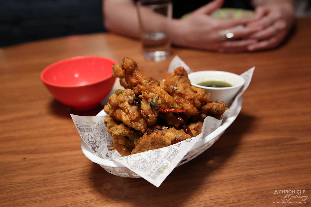 Rice Queen - KFC - Eric's seven spice crispy chicken ribs tossed with spring onions and whole chillis served with a basil & mint dipping sauceKFC - Eric's seven spice crispy chicken ribs tossed with spring onions and whole chillis served with a basil & mint dipping sauce (12 for $26) (12 for $26)