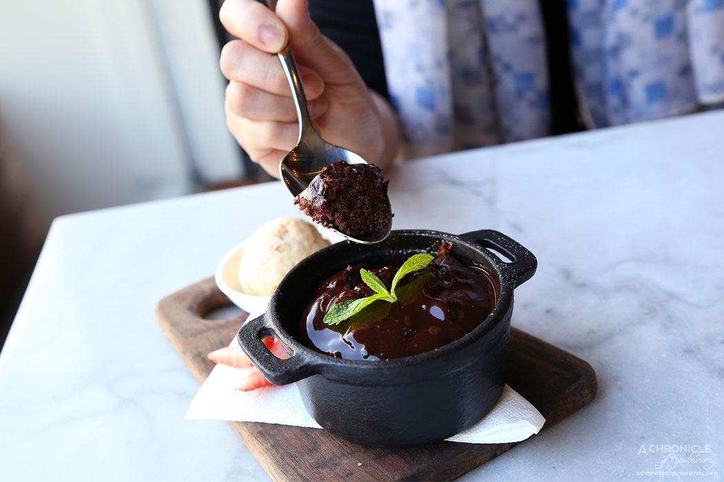 The North Melbourne Hotel - Flourless Chocolate Pudding, hazelnut praline gelato, rich chocolate ganache ($12)