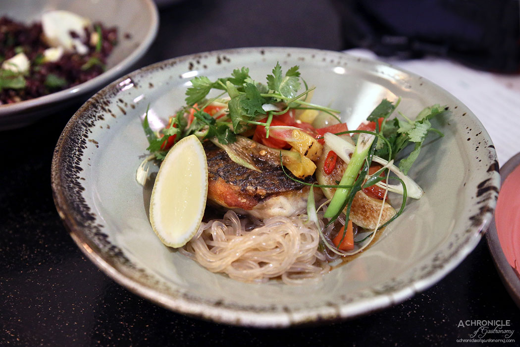 Uncle - Pan seared barramundi w glass noodles, tamarind caramel, tomato and grilled pineapple salad ($34)