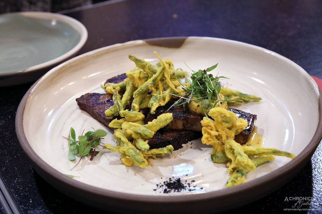 Uncle - Grilled Sher wagyu brisket w turmeric green bean fritters and cafe de Paris butter ($35)