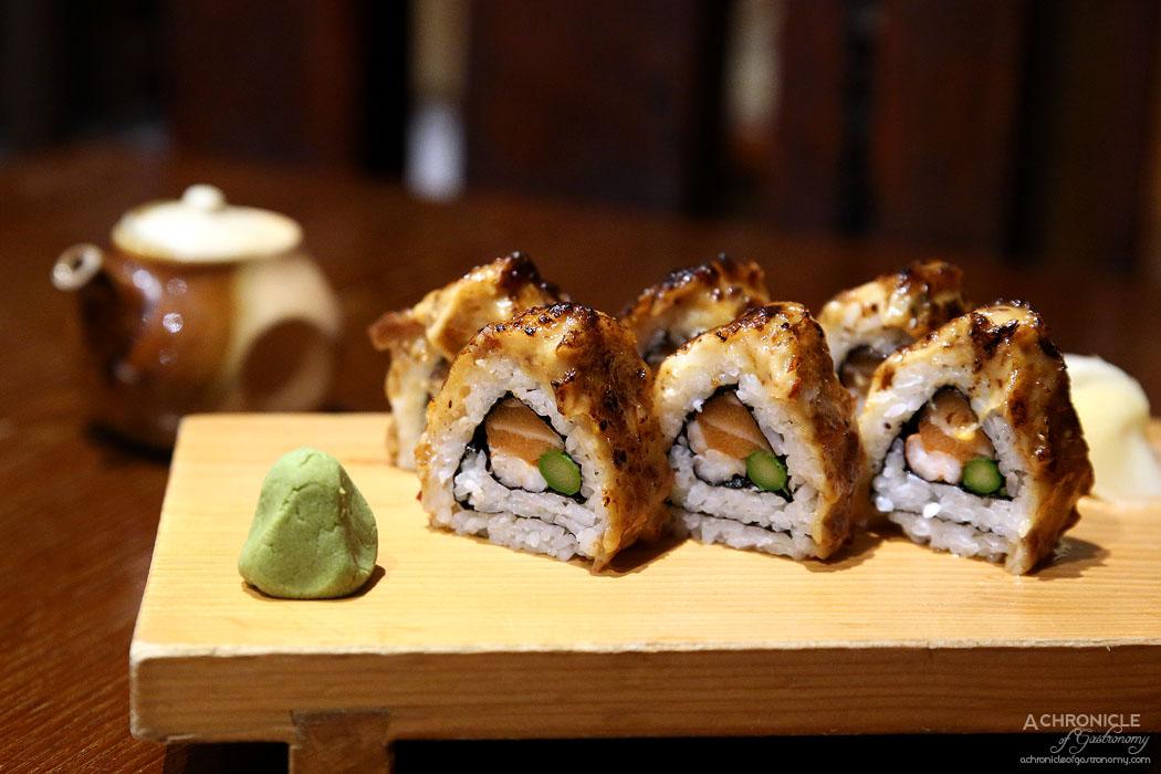 Hibachi - Volcano Roll - Nori roll w prawn, salmon, & asparagus glazed with spicy scallop mayo ($19.80)